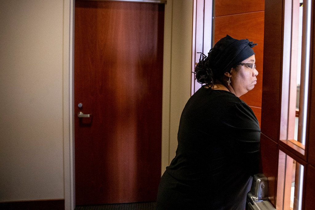 Stacey Jackson leaves the courtroom on Monday during a brief recess at George Allen courthouse. She is expected to testify Tuesday.