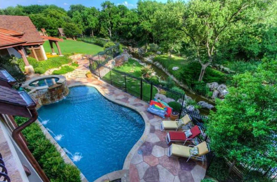 The North Dallas house is on almost an acre.