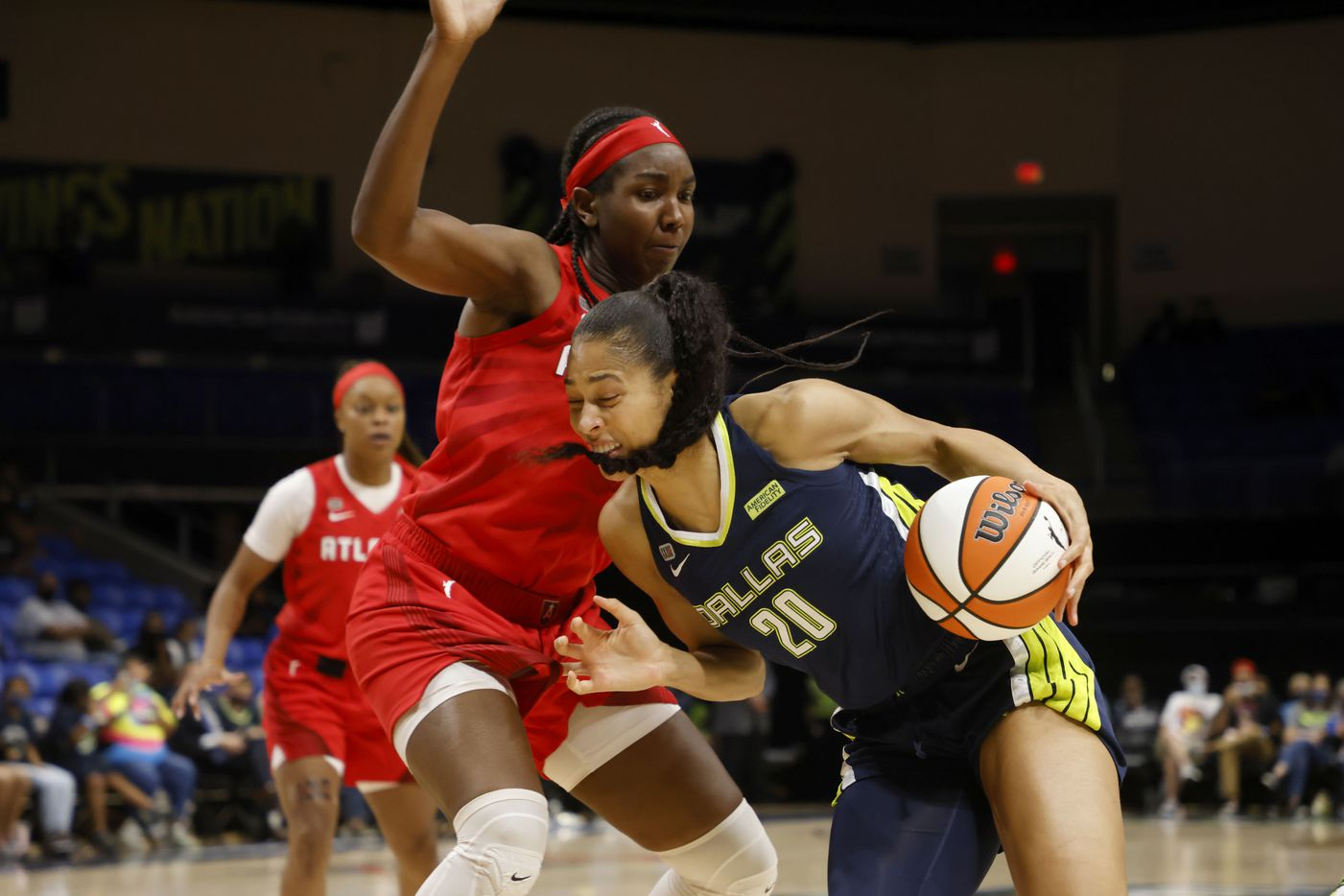 Dallas Wings forward Isabelle Harrison (20) tries to get past Atlanta Dream center/forward Elizabeth Williams, left during the first half of their WNBA basketball game in Arlington, Texas on Sept. 2, 2021. (Michael Ainsworth/Special Contributor)