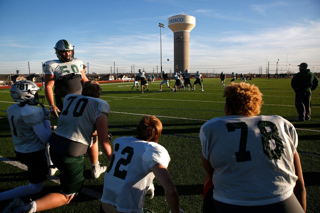 Players rest on the sidelines during practice at Rick Reedy High School in Frisco. Frisco ISD, which charged high school students $200 to participate in athletics starting in 2017, has decided to stop the pay-to-play fee for the upcoming school year.