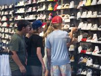 A group of kids browse shoes inside Finish Line shoe store at NorthPark Center in Dallas last month.