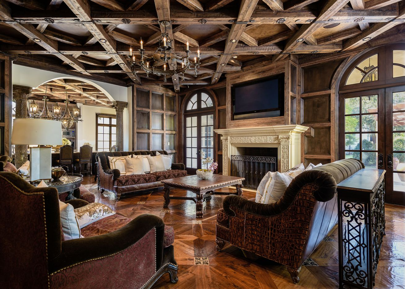 The French inspired estate has 10 living areas and four dining areas.