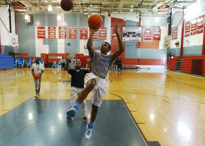 Seventh-grader Jody Chappell went up for a layup at Sam Houston Middle School in Irving in this 2019 file photo.