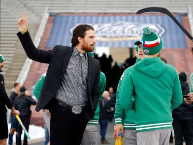 FILE - Stephen Johns (left) visits with his Stars teammates as they get acclimated to the cold weather before the Winter Classic against the Nashville Predators at the Cotton Bowl in Dallas on Wednesday, Jan. 1, 2020.