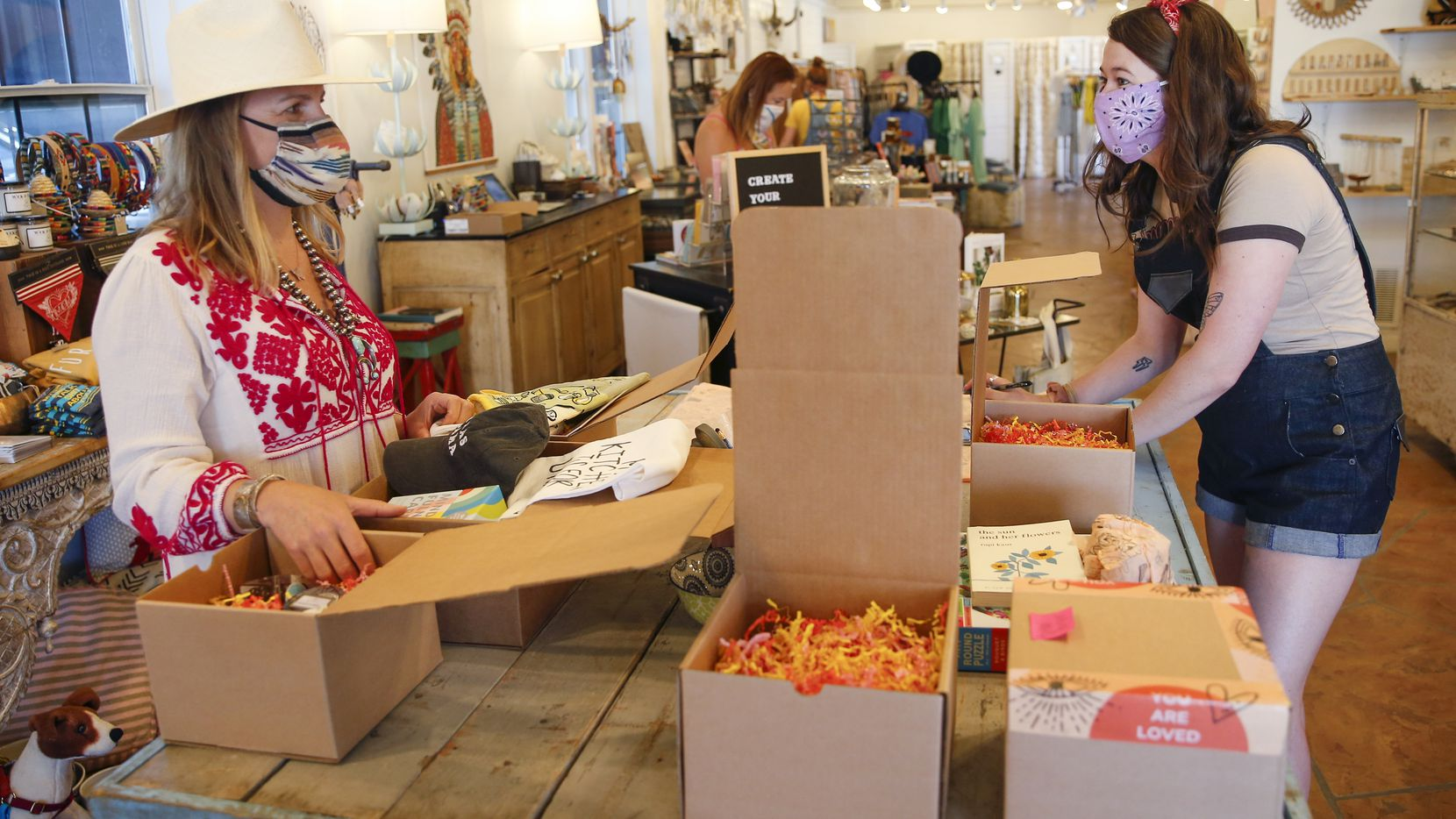 Owner Carley Seale, left, helps pack up orders with Mary Walton at Favor The Kind store in Dallas on Thursday.