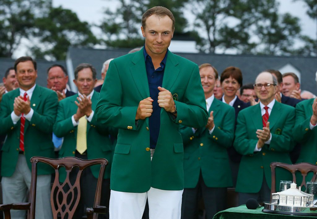 Jordan Spieth beams as he snugs up his green jacket after winning the Masters on Sunday, April 12, 2015, at Augusta National Golf Club in Augusta, Ga. (Curtis Compton/Atlanta Journal-Constitution/TNS)