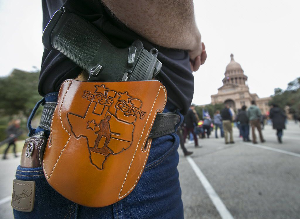 Open-carry advocates, who did not want to be identified by name, brought their firearms to a Come and Take It gun rally during the first day of the 84th legislative session outside the state Capitol on Tuesday.