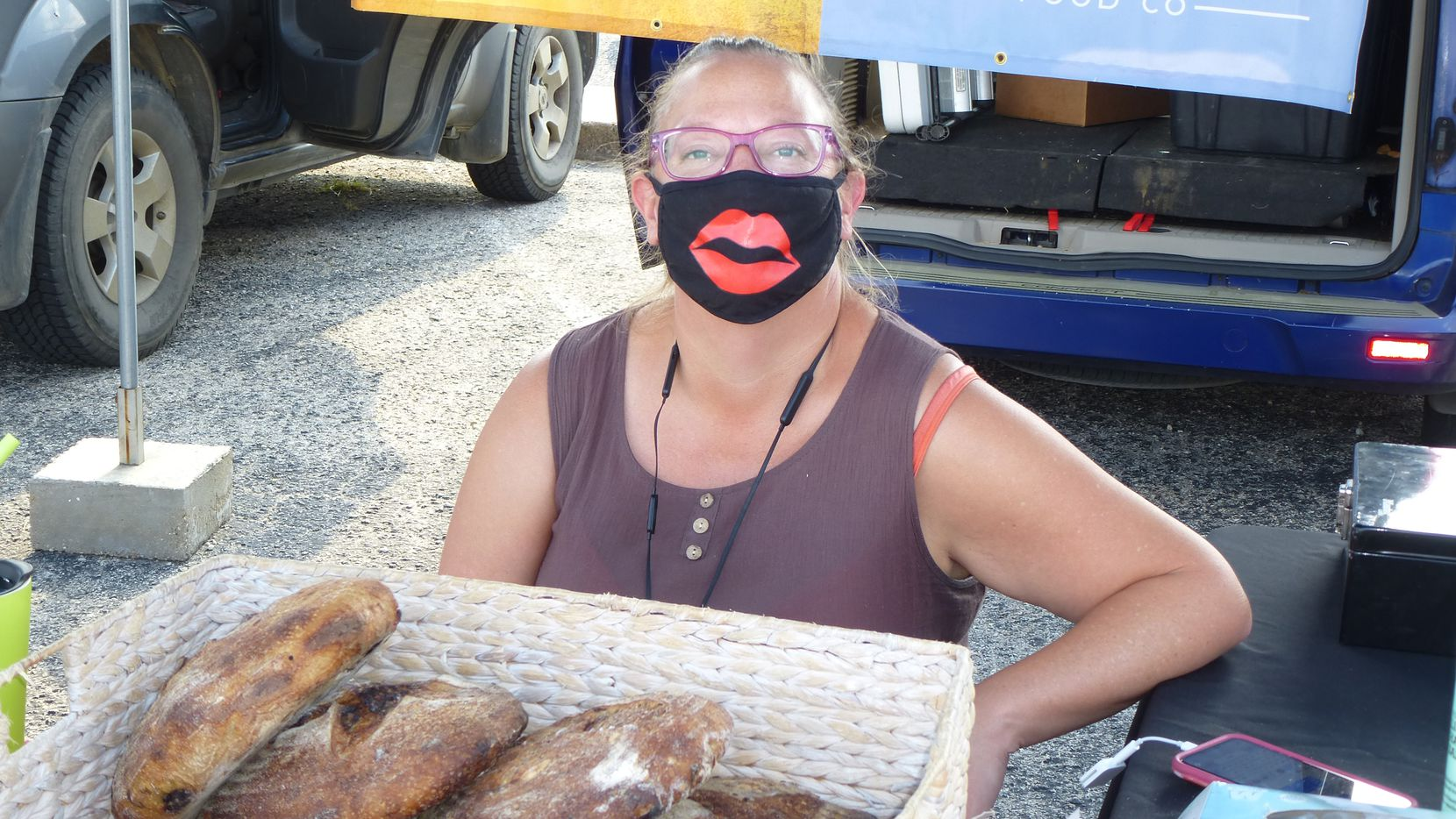 How about that kisser on Dana Shasken, who owns Mockingbird Food Co. She's one of many vendors finding ways to lighten the mood during COVID times at Cowtown Farmers Market in Fort Worth.