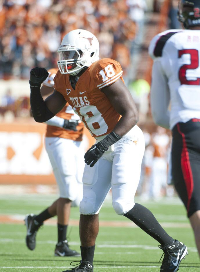Former Texas linebacker Emmanuel Acho gives a signal during Texas' 52-20 win over Texas Tech in Austin on Nov. 5, 2011. (Brendan Maloney-US PRESSWIRE)