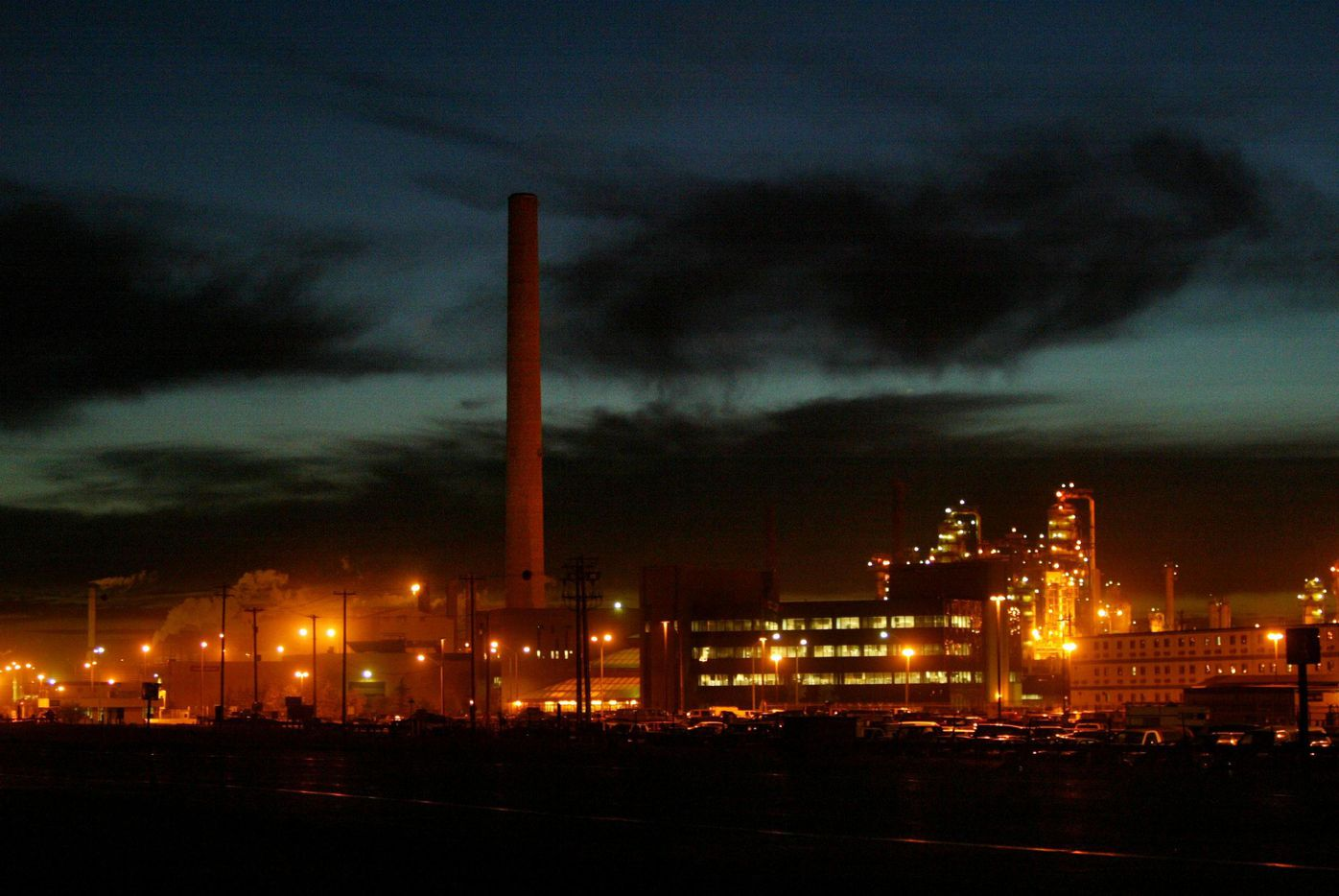 2005 FILE PHOTO -- Syncrude Canada Ltd.'s upgrader facility in Alberta looks like a city at night complete with housing for oil workers right on the site.