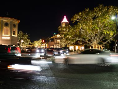 Christmas lights decorate the streets of the Highland Park Village shopping center. The trees have always been lit white, says the general manager.