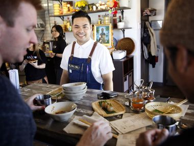 In this file photo, chef-owner Donny Sirisavath visits with diners at Khao Noodle Shop on March 9, 2019. Nearly two years later, the restaurant is temporarily closed. In its place, a takeout restaurant named Khao Gang will open.