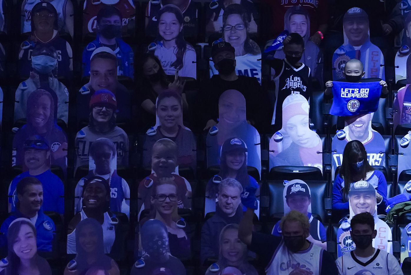 LA Clippers fans cheer among cardboard cutouts before an NBA playoff basketball game against the Dallas Mavericks at Staples Center on Tuesday, May 25, 2021, in Los Angeles.