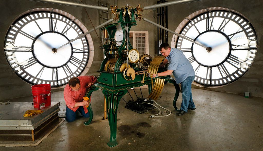 Historic clock restoration specialist Chuck Roeser (right) of Lockport, New York and his assistant Tony Clower wipe away the oil after lubricating the E. Howard & Co. tower clock in the old, red Dallas County Courthouse, now known as Old Red Museum, in downtown Dallas, Saturday, March 9, 2019. Roeser makes a pair of trips every year to adjust, clean and set the daylights savings time, which begins early Sunday morning.