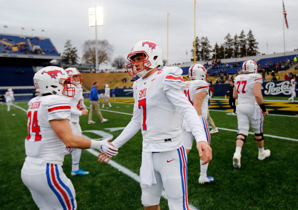 Southern Methodist Mustangs quarterback Shane Buechele (7) greets his teammates for pregame warmups before facing Navy at Navy-Marine Corps Memorial Stadium in Annapolis, Maryland, Saturday, November 23, 2019. (Tom Fox/The Dallas Morning News)