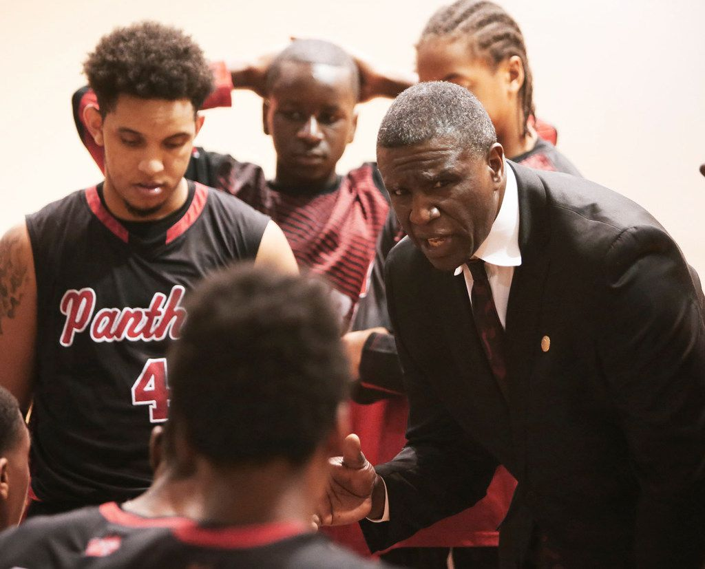 Von Harris coaches the Hillcrest High boys basketball team during a playoff game with Seagoville in February.