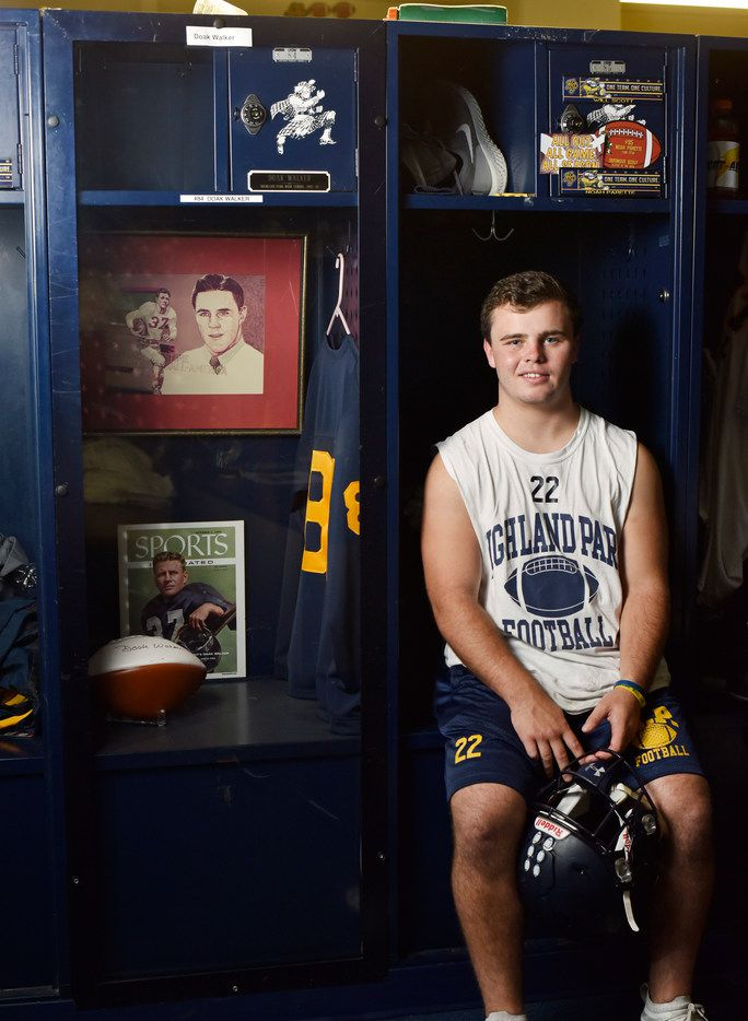 Highland Park senior running back Doak Walker sits next to the tribute locker to his grandfather Doak Walker, Sept. 24, 2019 at Highland Park High School in Dallas. The elder Doak Walker played at Highland Park and went on to win a Heisman Trophy while playing college football at SMU. Doak was later inducted into the Pro Football Hall of Fame. He died in 1998 from injuries suffered in a skiing accident.