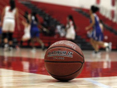 A basketball is pictured court-side during the second half of the Dallas Woodrow Wilson versus Dallas Spruce basketball game.