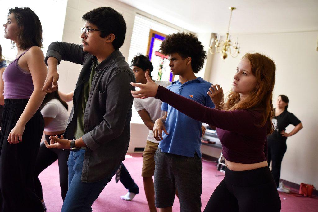 Ollin Barraza Fernandez, 18, left, Landon Robinson, 15, and Angie Hogue, 17, right, rehearse Cry Havoc Theater Company's Crossing the Line.