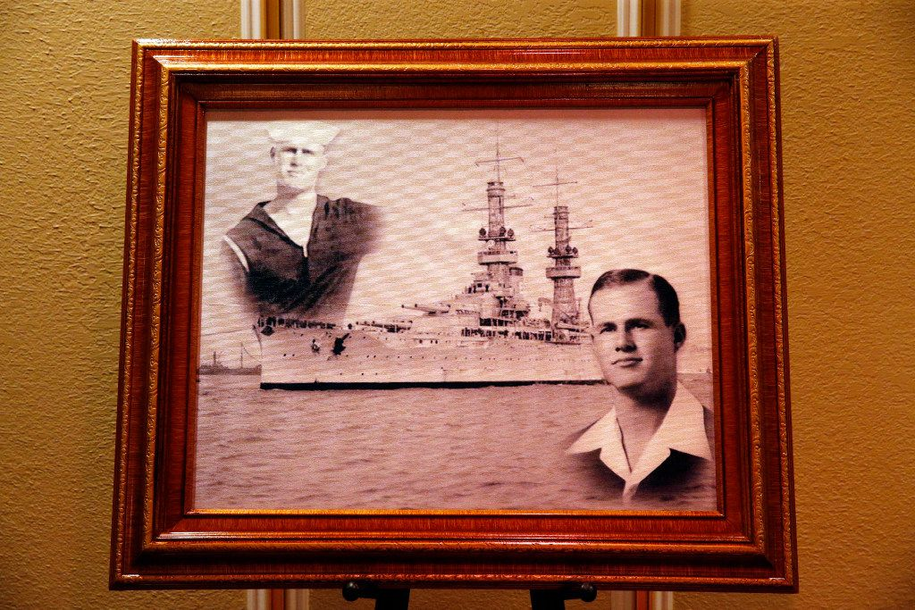 A framed photo of Navy Seaman 1st  Class (E3) George A. Coke Jr. of Arlington is pictured at Moore Funeral Home after his remains were returned from Pearl Harbor via a commercial flight at Dallas-Fort Worth International Airport, Friday, June 23, 2017. Coke, who perished in the USS Oklahoma after it sank, was identified through recent DNA testing. The North Texas Patriot Guard Riders joined the procession to Moore Funeral Home in Arlington. A service will be held at First United Methodist Church in central Arlington Saturday before being buried at Parkdale Cemetery.