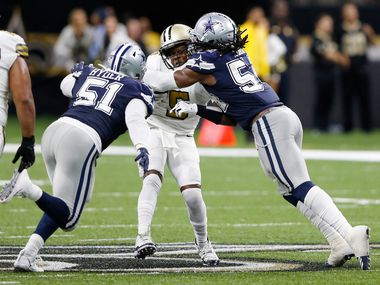 FILE - Cowboys linebacker Jaylon Smith (54) sacks Saints quarterback Teddy Bridgewater (5) on a third-down play as Cowboys defensive end Kerry Hyder (51) closes in during the second half of a game at the Superdome in New Orleans on Sunday, Sept. 29, 2019.