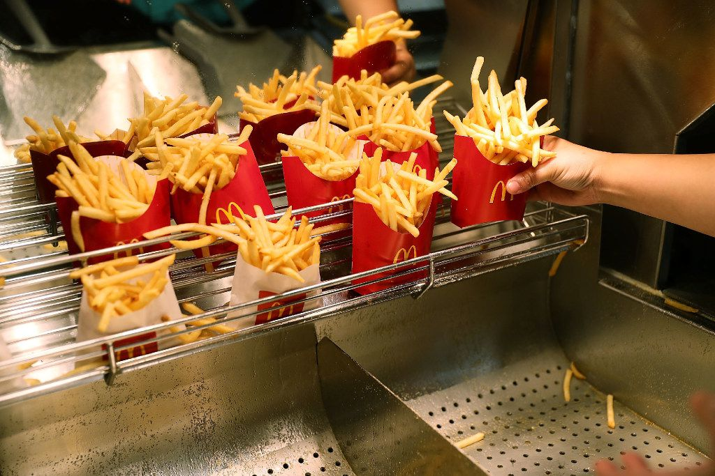 McDonald's crew member Samantha Medina prepares french fries at a the McDonald's restaurant in Miami in an April file photo. McDonald's tested delivery for several months, beginning Jan 30 in select restaurants in Miami, Tampa and Orlando.has launched.