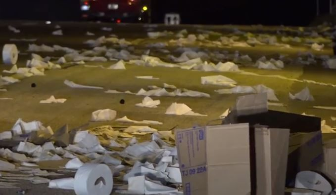 Toilet paper lies along Interstate 20 in Hutchins after an 18-wheeler crashed Wednesday morning. No one was injured.