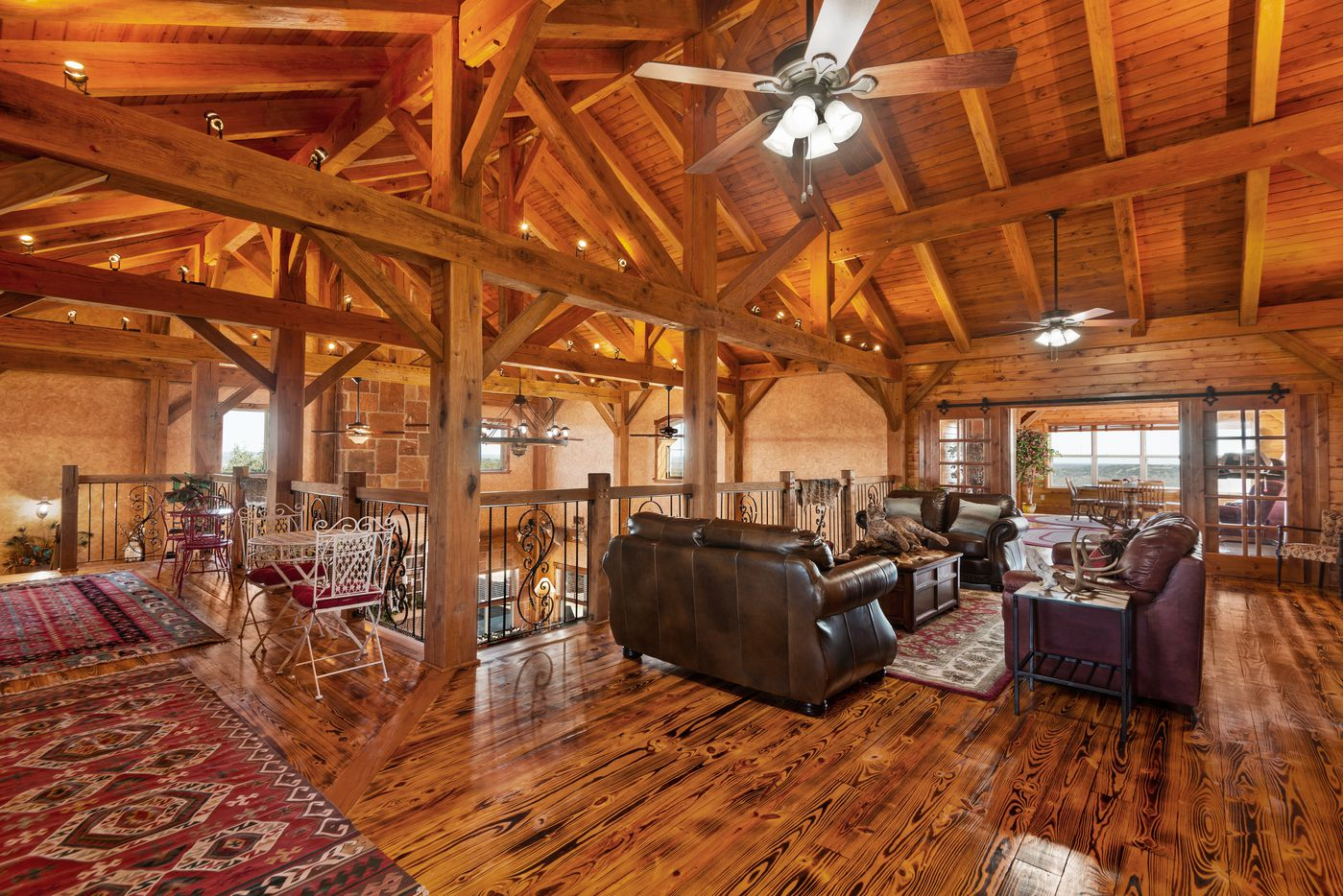 The lodge style ranch house is six years old.