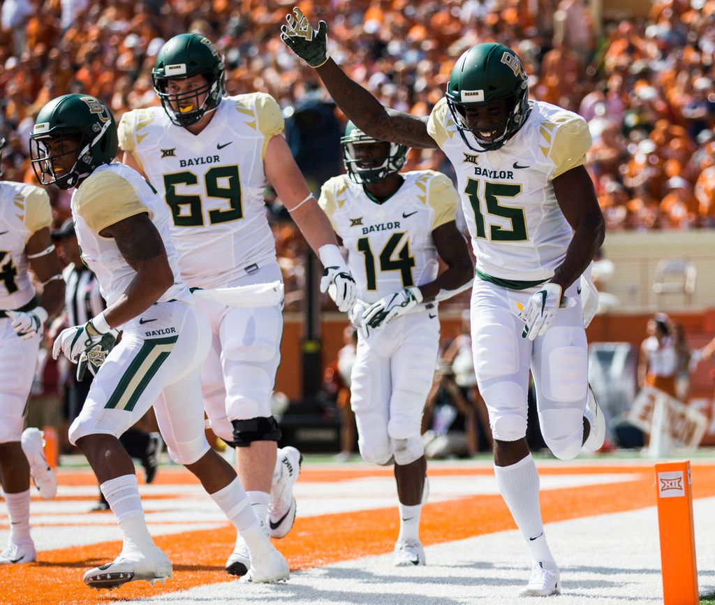 Baylor Bears wide receiver Denzel Mims (15) celebrates a touchdown during the first quarter of a college football game between Baylor and the University of Texas on Saturday, October 13, 2018 at Darrell K Royal Memorial Stadium in Austin, Texas.  (Ashley Landis/The Dallas Morning News)