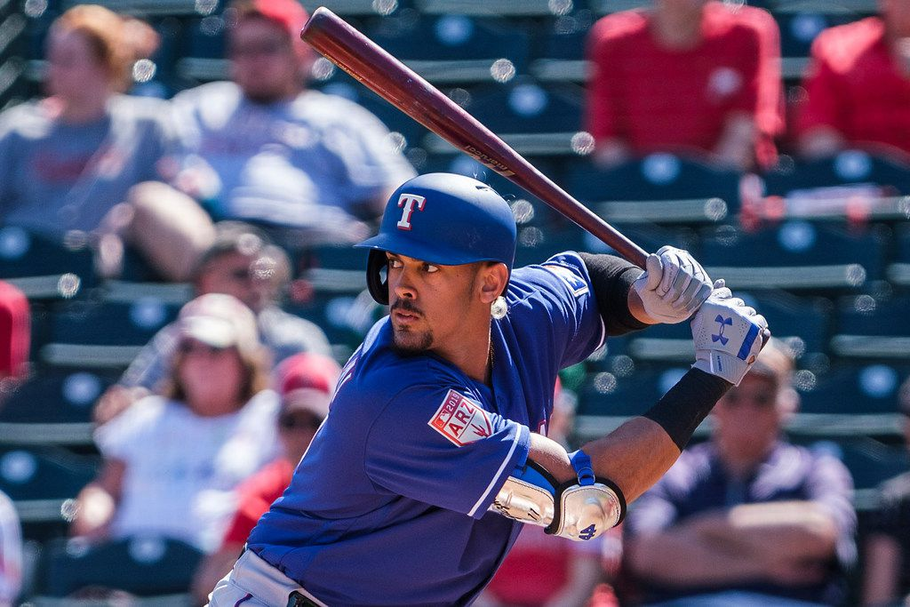 Texas Rangers first baseman Ronald Guzman bats during the second inning of a spring training baseball game against the Los Angeles Angels on Thursday, Feb. 28, 2019, in Tempe, Ariz.. (Smiley N. Pool/The Dallas Morning News)