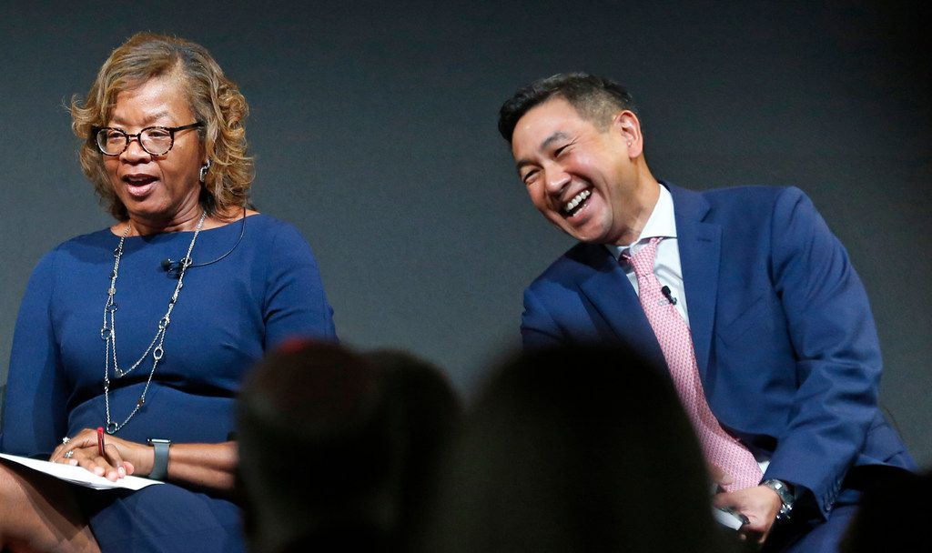 Alfreda Norman of the Federal Reserve Bank of Dallas shares a laugh with George Tang, managing director of Educate Texas, during a panel discussion on STEM education and workforce development, held at Toyota North American Headquarters in Plano.