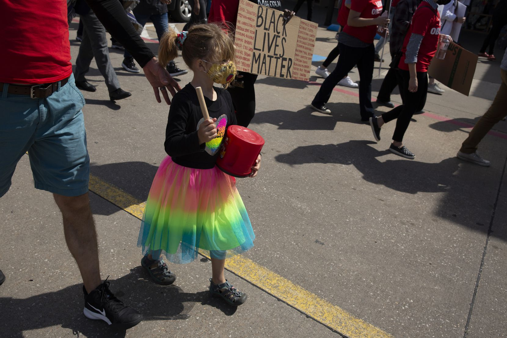 Naomi Ridenour, 6, hits drum to the beat of a chant during a march at the Allen Outlets on Sunday, March 21, 2021 demanding justice for Marvin Scott III, who died a week prior while in custody at the Collin County Jail on March 14, 2021. Demonstrators called for the arrest of the ÒCollin County SevenÓ, the seven Collin County Jail employees who were placed on leave after MarvinÕs death. (Shelby Tauber/Special Contributor)