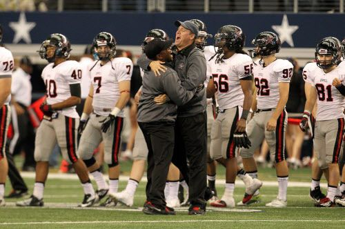 Coppell Head Coach Joe McBride, right, gets a hug from an assistant following a 31-7 win over Irving MacArthur in bi-district playoff football action at Cowboys Stadium in Arlington, Texas Saturday, November 17, 2012. (Brad Loper/The Dallas Morning News)