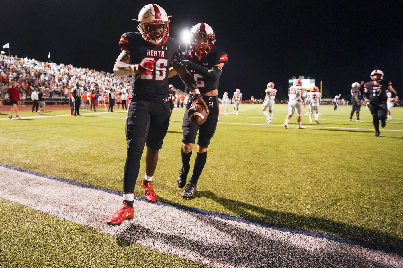 Rockwall-Heath running back  Zach Evans (26) celebrates after scoring on a 3-yard touchdown during overtime in a District 10-6A high school football game against Rockwall at Wilkerson-Sanders Stadium on Friday, Sept. 24, 2021, in Rockwall.  Rockwall-Heath won the game 79-71 in double overtime.