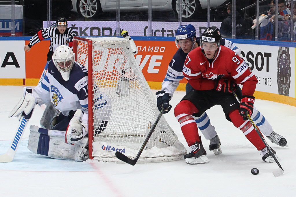 MOSCOW, RUSSIA - MAY 22: Connor McDavid #97 of Canada plays the puck against Esa Lindell #7 of Finland during the 2016 IIHF World Championship gold medal game at the Ice Palace on May 22, 2016 in Moscow, Russia. Canada defeated Finland 2-0. (Photo by Anna Sergeeva/Getty Images)