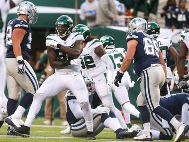 New York Jets linebacker Tarell Basham (93) celebrates after stopping the Cowboys on a 4th down and 2 yards play in the first half of an NFL game between the Dallas Cowboys and New York Jets on Sunday, October 13, 2019 at MetLife Stadium in East Rutherford, New Jersey. (Shaban Athuman/Staff Photographer)