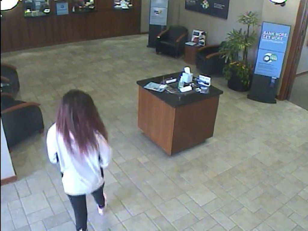 Arlington police released surveillance footage of a woman who robbed the BBVA Compass bank on South Cooper Street on Thursday.
