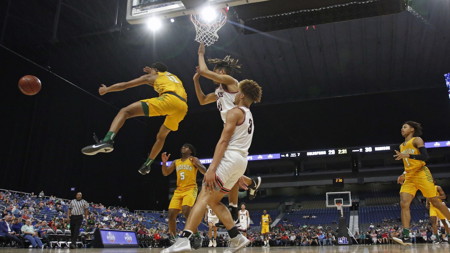 FILE - Madison guard Jerome Rogers Jr. (11) makes a pass after driving the lane. Madison defeated Coldspring-Oakhurst 90-73 in a Class 3A semifinal game on Thursday, March 12, 2020, at the Alamodome in San Antonio.