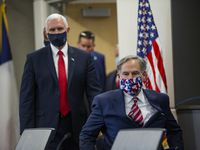 Vice President Mike Pence (left) and Gov. Greg Abbott walk in before a press gaggle on the coronavirus pandemic at University of Texas Southwestern Medical Center on Sunday, June 28, 2020, in Dallas. (Juan Figueroa/ The Dallas Morning News)