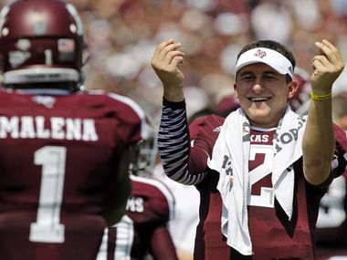 Texas A&M Aggies quarterback Johnny Manziel (2) celebrates a touchdown by  running back Ben Malena (1) as they played the Rice Owls during their NCAA football game at Kyle Field in College Station , Texas, on August 31, 2013.