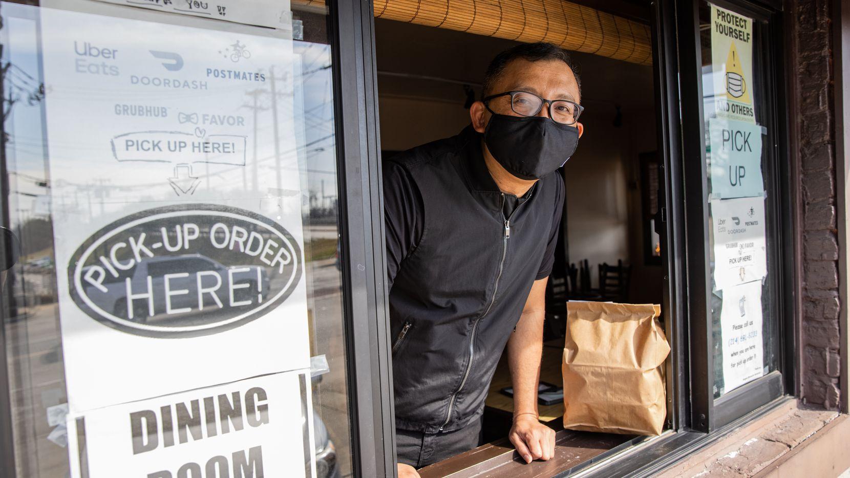 Joe Pumphuang of Bangkok at Greenville poses at the restaurant's walk-up window.