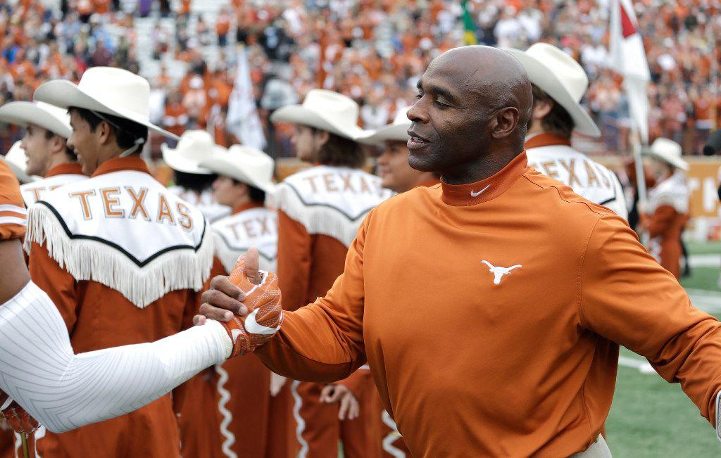 Texas head coach Charlie Strong greets his senior players before an NCAA college football game against TCU, Friday, Nov. 25, 2016, in Austin, Texas. (AP Photo/Eric Gay)