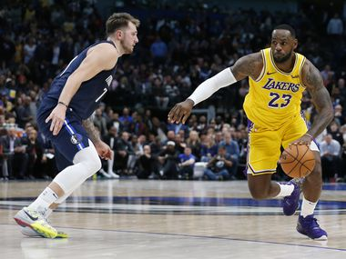 Los Angeles Lakers forward LeBron James (23) dribbles up the court as he is defended by Dallas Mavericks guard Luka Doncic (77) during the second half of play at American Airlines Center in Dallas on Friday, November 1, 2019.