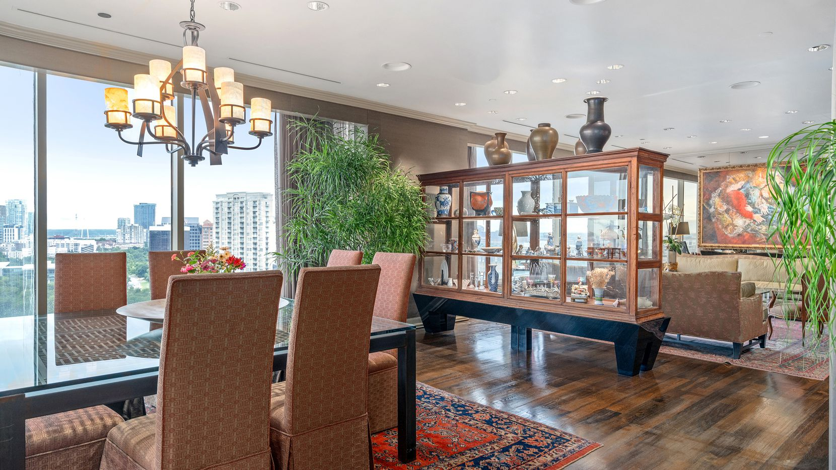 The renovated residence at 3510 Turtle Creek Blvd. unit 12F at Claridge Condos provides views of Turtle Creek Park and the skyline.