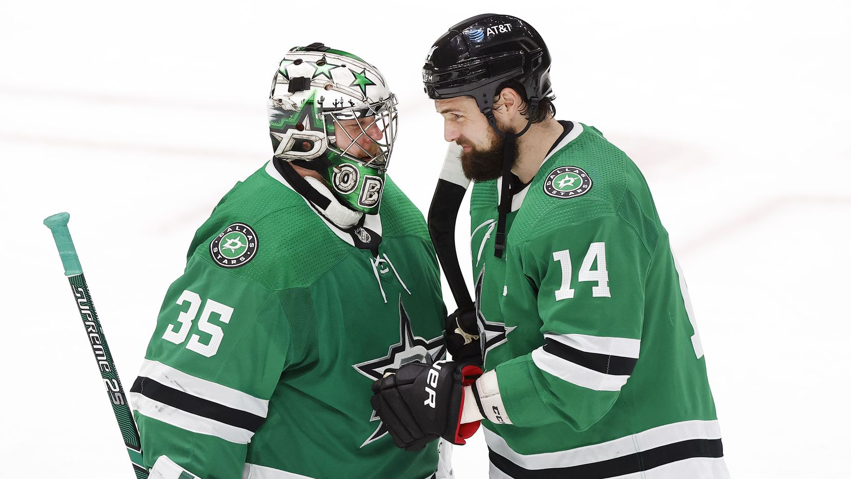 Dallas Stars left wing Jamie Benn (14) congratulates goaltender Anton Khudobin (35) on their win over the Chicago Blackhawks at the American Airlines Center in Dallas, Tuesday, March 9, 2021. The Stars defeated the Blackhawks, 6-1.