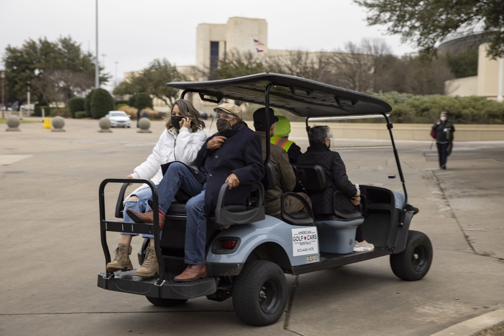 A cart takes people to get vaccines at Fair Park in Dallas on Tuesday, Feb. 9, 2021. (Juan Figueroa/ The Dallas Morning News)