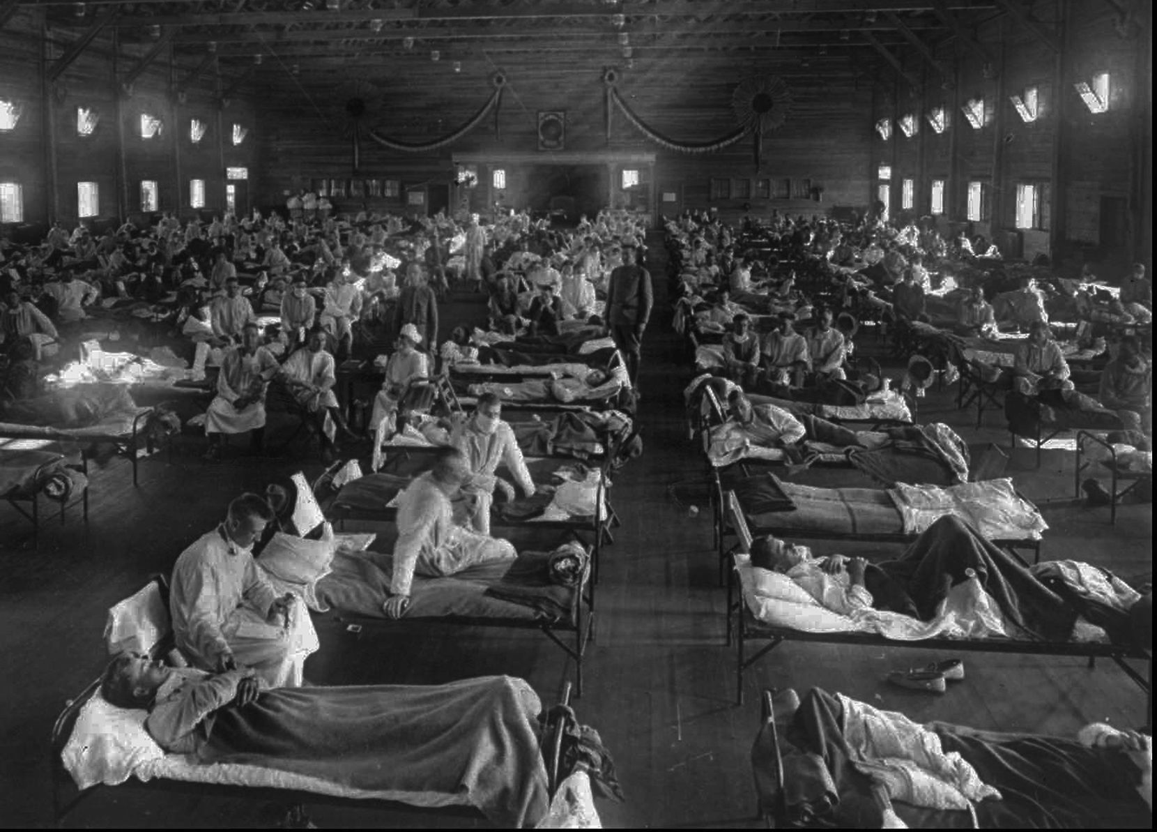 Victims of the 1918 Spanish influenza crowded into an emergency hospital at Fort Riley, Kan. The 1918 pandemic is believed to have killed more than 50 million people worldwide. The virus strain had been mild in the spring but turned deadly that fall. In Dallas and elsewhere, entire families were wiped out and many children were orphaned.