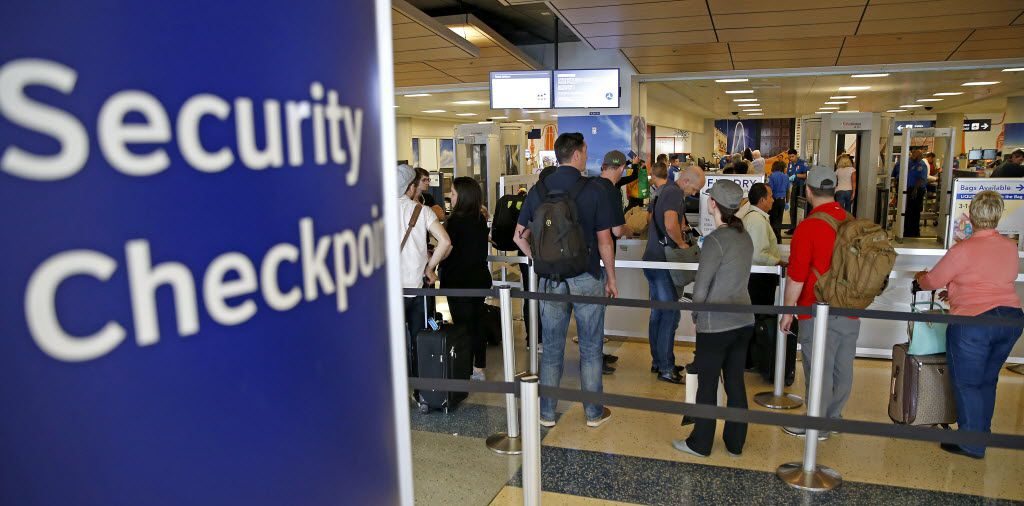 Travelers waited to go through a DFW Airport security checkpoint earlier this year. (Jae S. Lee/Staff Photographer)