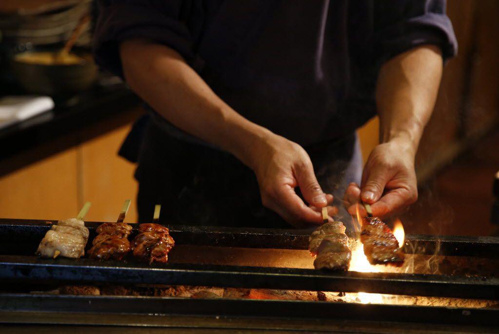 Teppo chef-owner Masayuki Otaka grills yakitori at Teppo.