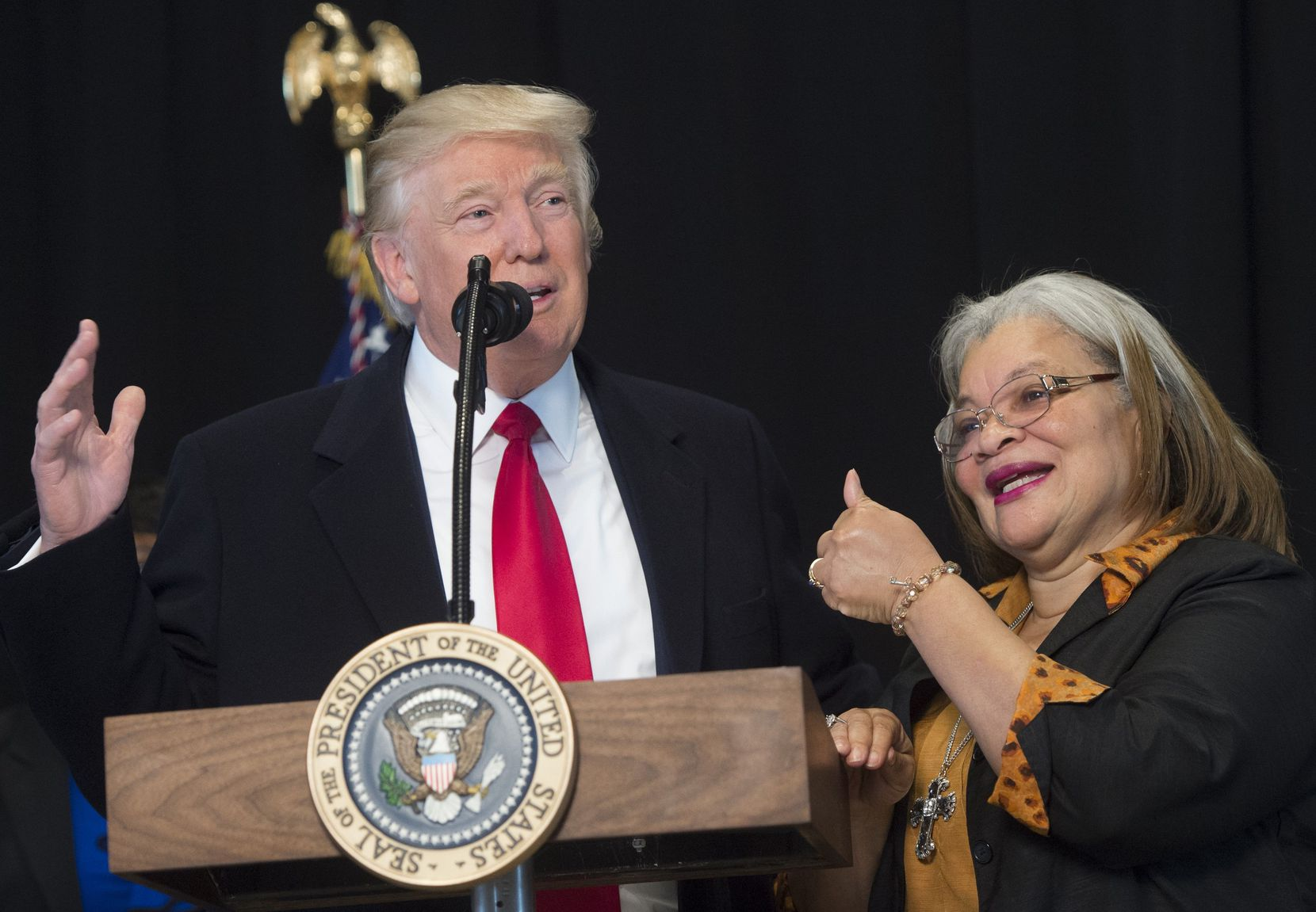 US President Donald Trump speaks as Alveda King (R), niece of civil rights icon Dr. Martin Luther King, Jr., gives a thumbs-up, following a tour of the Smithsonian National Museum of African American History and Culture in Washington, DC, February 21, 2017.